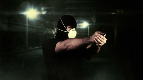Masked Man With Gun Shooting In Scary Alley 1 stock footage