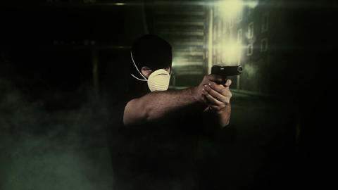 Masked Man with Gun Shooting in Scary Alley 3 Stock Video Footage