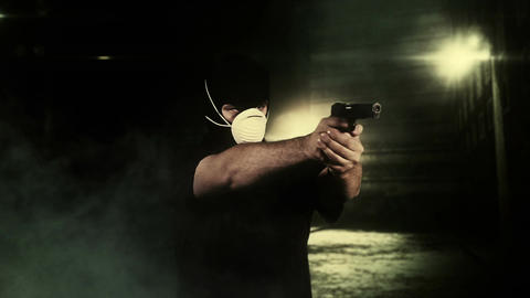 Masked Man with Gun Shooting in Scary Alley 5 Stock Video Footage