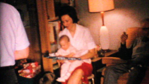 Baby Tries To Open Christmas Gift 1967 Vintage 8mm film Footage