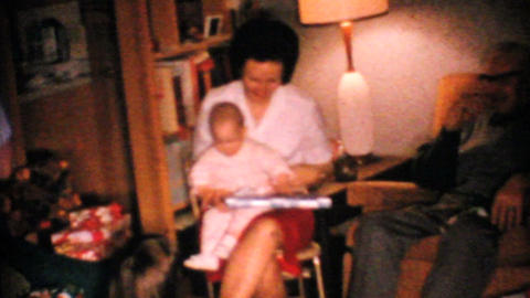 Baby Tries To Open Christmas Gift 1967 Vintage 8mm film Stock Video Footage