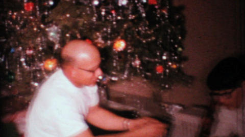 Man Gets Funny Gag Gift For Christmas 1967 Vintage 8mm film Stock Video Footage