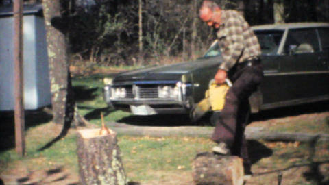 Old Man Using A Chainsaw 1968 Vintage 8mm film Stock Video Footage
