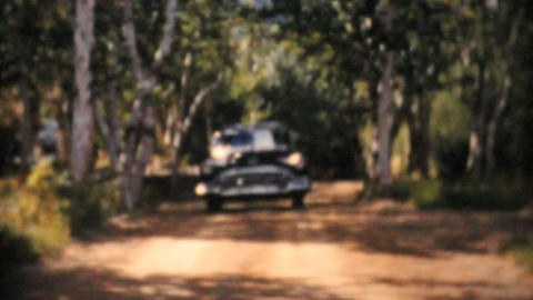 Cadillac 1956 Driving On Country Road Vintage 8mm film Stock Video Footage