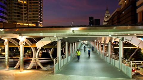 Timelapse - Pedestrians in Skytrain walkway Footage