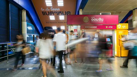 Timelapse - Money Exchange and Pedestrians taking escalator Stock Video Footage