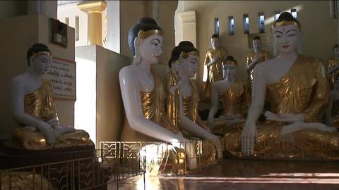 Statue at Shwedagon pagoda, Yangon Stock Video Footage