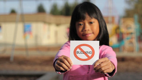 Girl Holding A NO BULLYING Sign Stock Video Footage