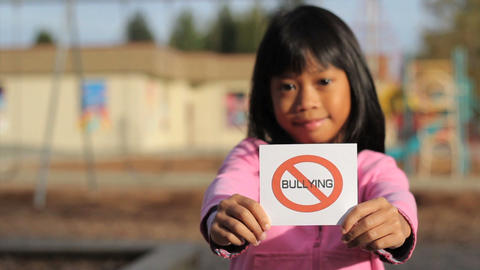 Girl Holding A NO BULLYING Sign Footage