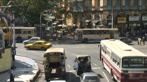 Traffic at Sule pagoda, Yangon Stock Video Footage