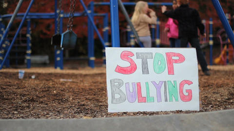 Frightened Girl With Stop Bullying Sign At School Stock Video Footage