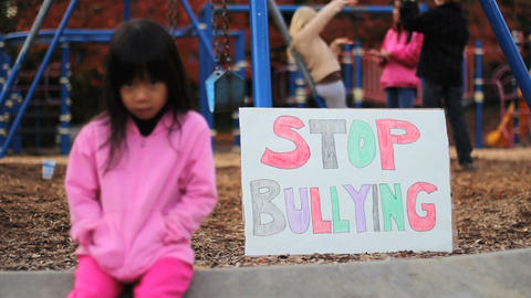 Frightened Girl With Stop Bullying Sign At School Footage