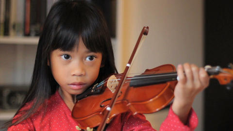 Intense 6 year Old Asian Girl Plays Her Violin Stock Video Footage
