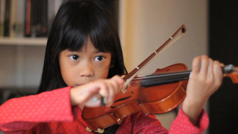Intense 6 year Old Asian Girl Plays Her Violin Footage