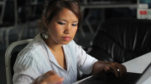 Female Asian Office Worker On Lap Top Stock Video Footage