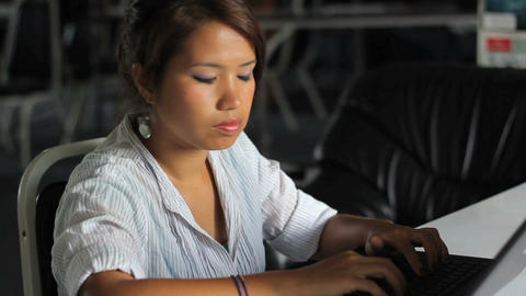 Female   Asian   Office   Worker   On   Lap   Top stock footage