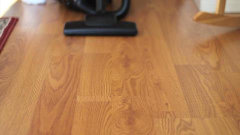 Housewife Vacuuming Laminate Floor Stock Video Footage