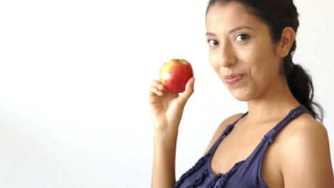 Young woman holding an apple Stock Video Footage