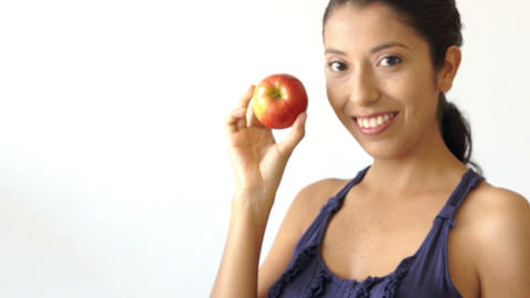 Young Woman Holding An Apple stock footage