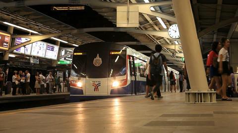 BTS train departing from platform station, Bangkok, Thailand Stock Video Footage