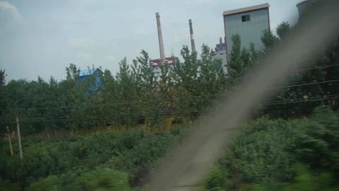 Oil tank chemical plants in rural countryside.Speeding train travel,scenery outs Footage