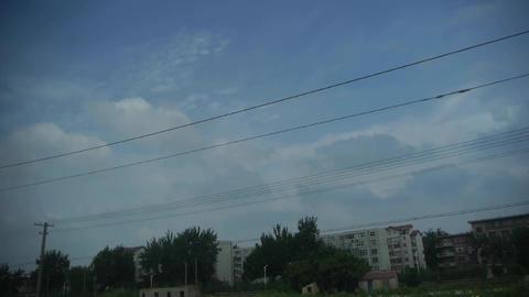 Altocumulus cloud in blue sky.Speeding train... Stock Video Footage