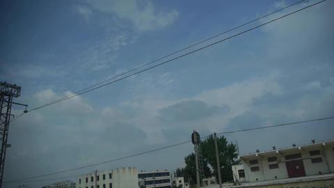 Altocumulus cloud in blue sky.Speeding train travel,scenery outside window Footage