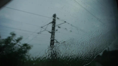 Rain hit glass in rainy season.Speeding train travel,scenery outside window Footage
