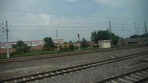 Speeding train travel,scenery outside window.train-station Footage