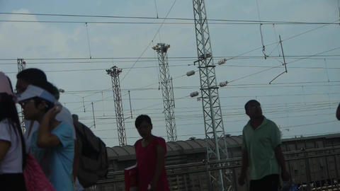 Travelers on railway station platforms.train... Stock Video Footage