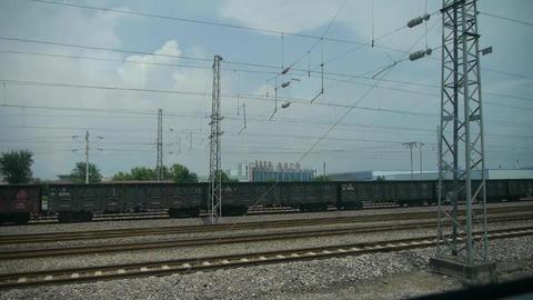 Speeding train travel,scenery outside window.train-station Footage