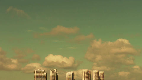 Movement of clouds in sky,building high-rise at urban city Footage