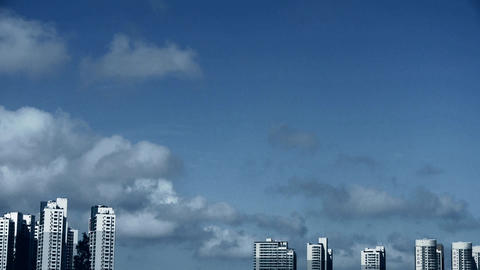 Movement of altocumulus clouds in sky,building high-rise at urban city Footage