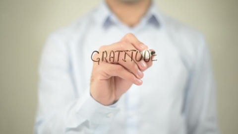 Gratitude Is Best Attitude , man writing on transparent screen Live Action
