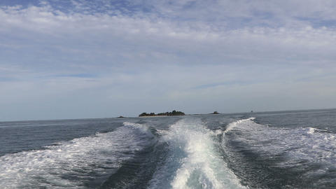 Wake of speed boat with blue sky back ground Footage