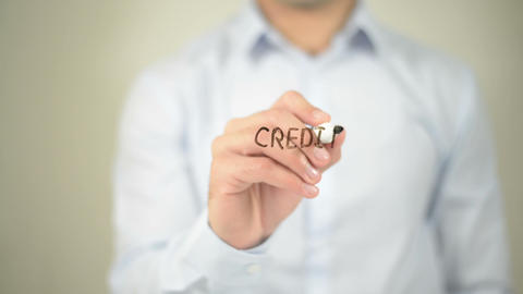 Credit Management , man writing on transparent screen Footage