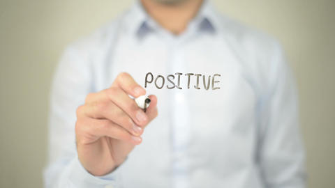Positive Attracts Positive , man writing on transparent screen Footage