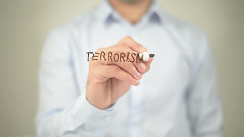 Terrorism Has No Religion , man writing on transparent screen Footage