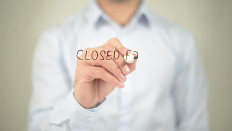 Closed for Maintenance, man writing on transparent screen Footage