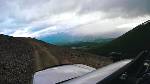 Drive a car uphill on a cloudy day. Auto travel: POV - Point of view SUV rides a Footage