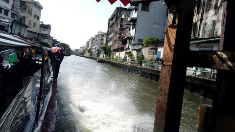Bangkok, Thailand - 2019-03-03 - Speeding Canal Boat Passes Under Bridge Footage