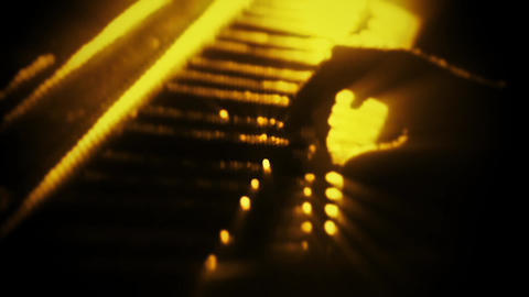 Man Playing a Yellow Particles Piano - Hands Close Up -…, Stock Animation