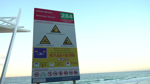 Beach warning sign during sunris Footage