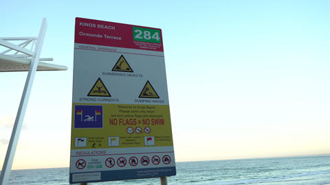 Beach warning sign during sunris Stock Video Footage