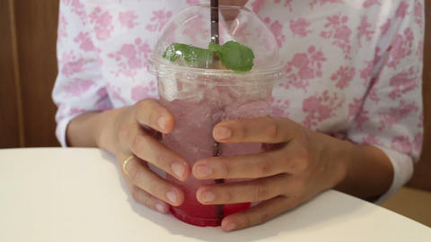 Woman tasting iced mix berry soda Live Action