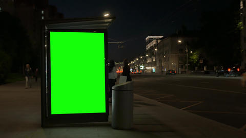 contemporary bus stop equipped with luminous green banners Footage
