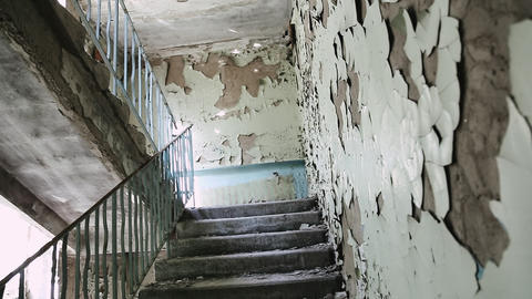 Staircase Inside an abandoned building. Half-ruined buildings in ghetto. Almost Live Action