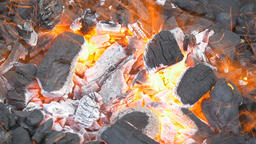 Black coals giving out an intense heat Live Action