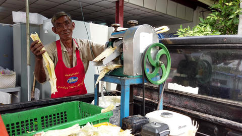 Bangkok, Thailand - 2019-03-17 - Man Uses Machine To Squeeze Sugar From Sugar Live Action