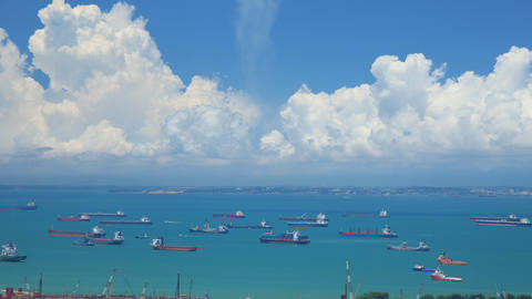 Time Lapse shot of hundreds of cargo ships anchored off the coast of Singapore Footage